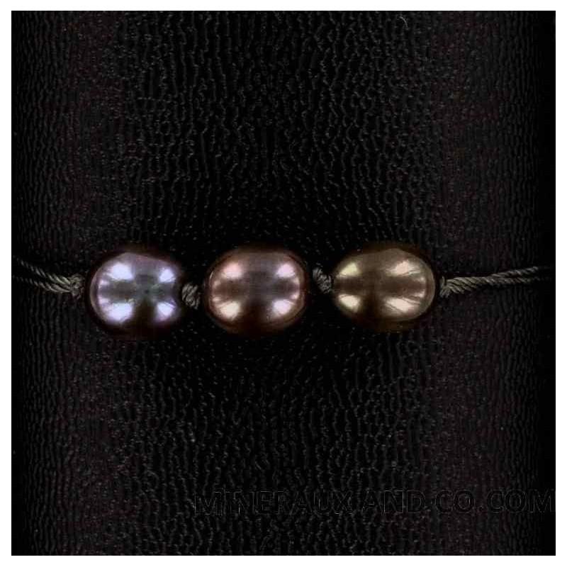 Bracelet trois perles de culture bleues-grises.