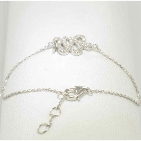 Bracelet serpent argent et zirconiums sertis.