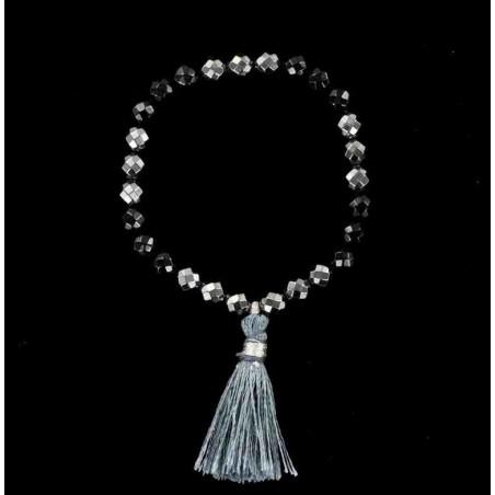 Bracelet perles d'onyx et d'hématite facettée avec pompon.