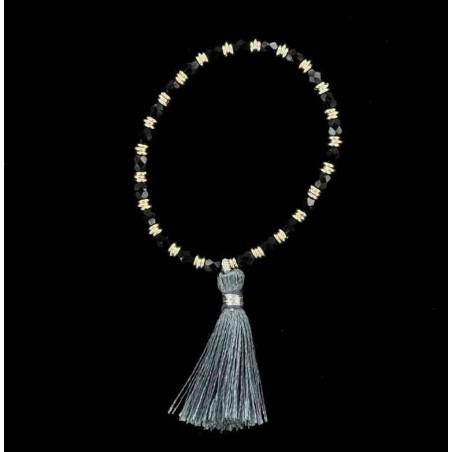 Bracelet perles d'onyx facettées, anneaux et pompon.